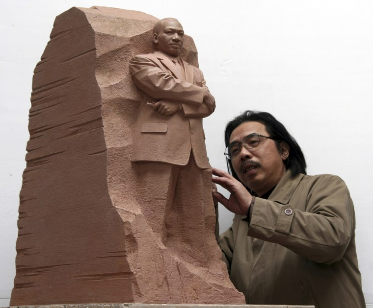 """Sculptor Lei Yixin of China looks at a scale model of the """"Stone of Hope,"""" a piece he has created that will be the centerpiece of a new memorial for the Rev. Martin Luther King Jr."""