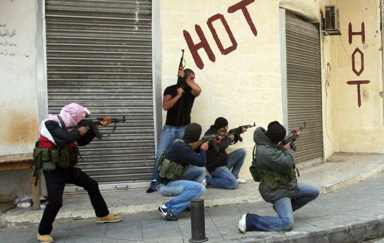 Image: Hezbollah and Amal group gunmen take position