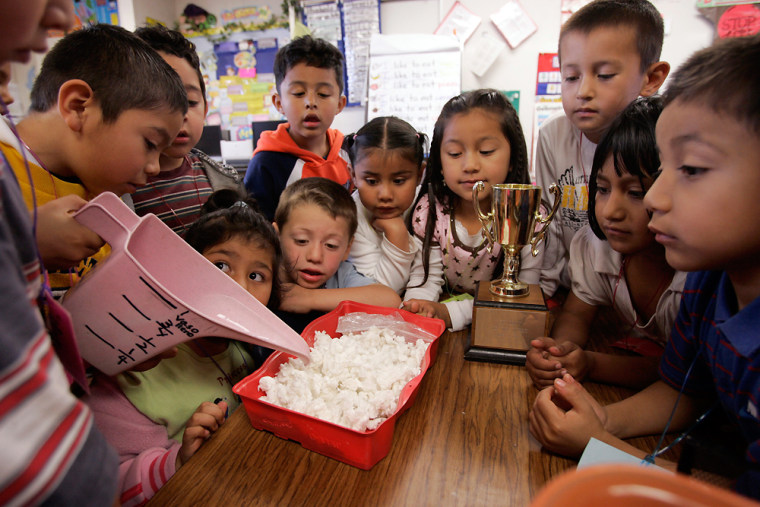 Image: First-grade students perform an experiment at Las Palmitas Elementary School