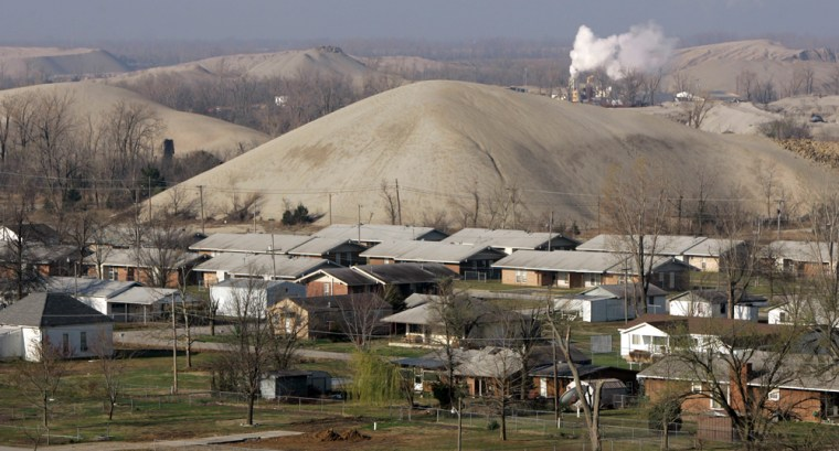 The town of Picher, Okla., is nestled among huge lead-laced piles of rock.Its population has dwindled to a fraction of its former size as people gradually move away from the Tar Creek Superfund site left from years of lead and zinc mining.