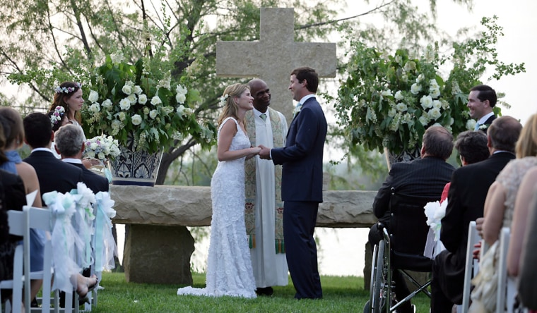Henry Hager and Jenna Bush exchange vows at the altar Saturday, May 10, 2008, at Prairie Chapel Ranch near Crawford, Texas. Presidingover the wedding ceremony is the Rev. Kirbyjohn Caldwell.