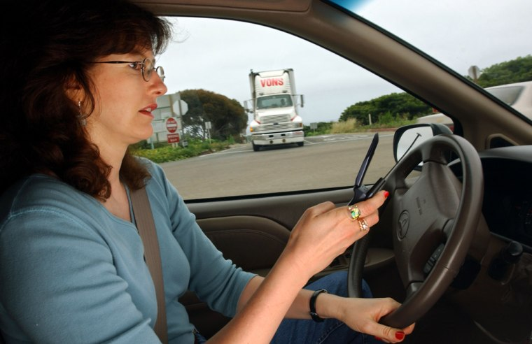 Image: Woman on cell phone in car