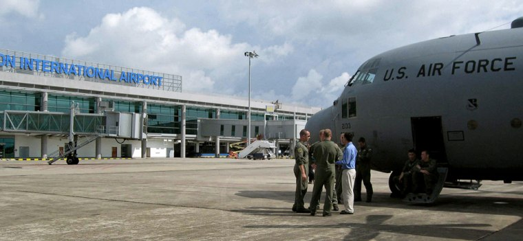 Image: A US Air Force plane is seen on the tarmac of Yangon airport