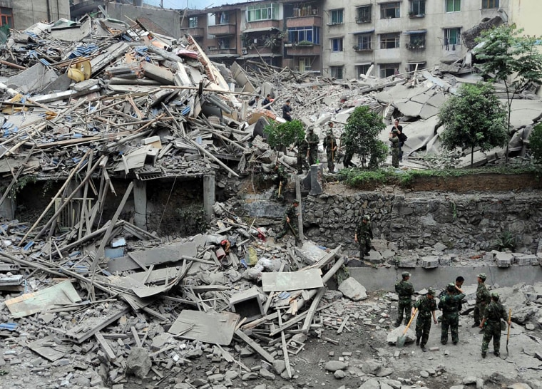 Image: Collapsed building for survivors in Beichuan, southwest China's Sichuan province