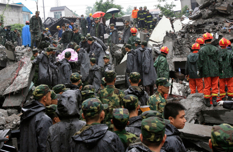 Image: Soldiers of the People's Liberation Army (PLA) search for survivors from the debris of a collapsed school building in Juyuan county of Dujiangyan