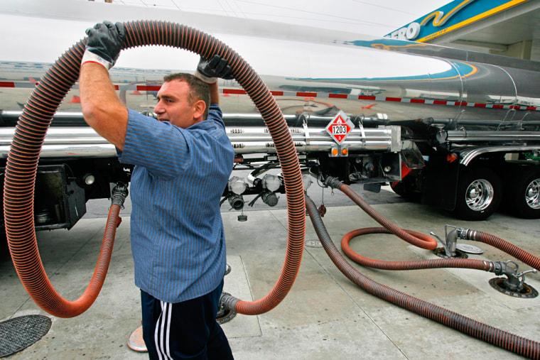Image: Tanker driver Artyyom Karapetyan delivering gasoline in Van Nuys, Calif.
