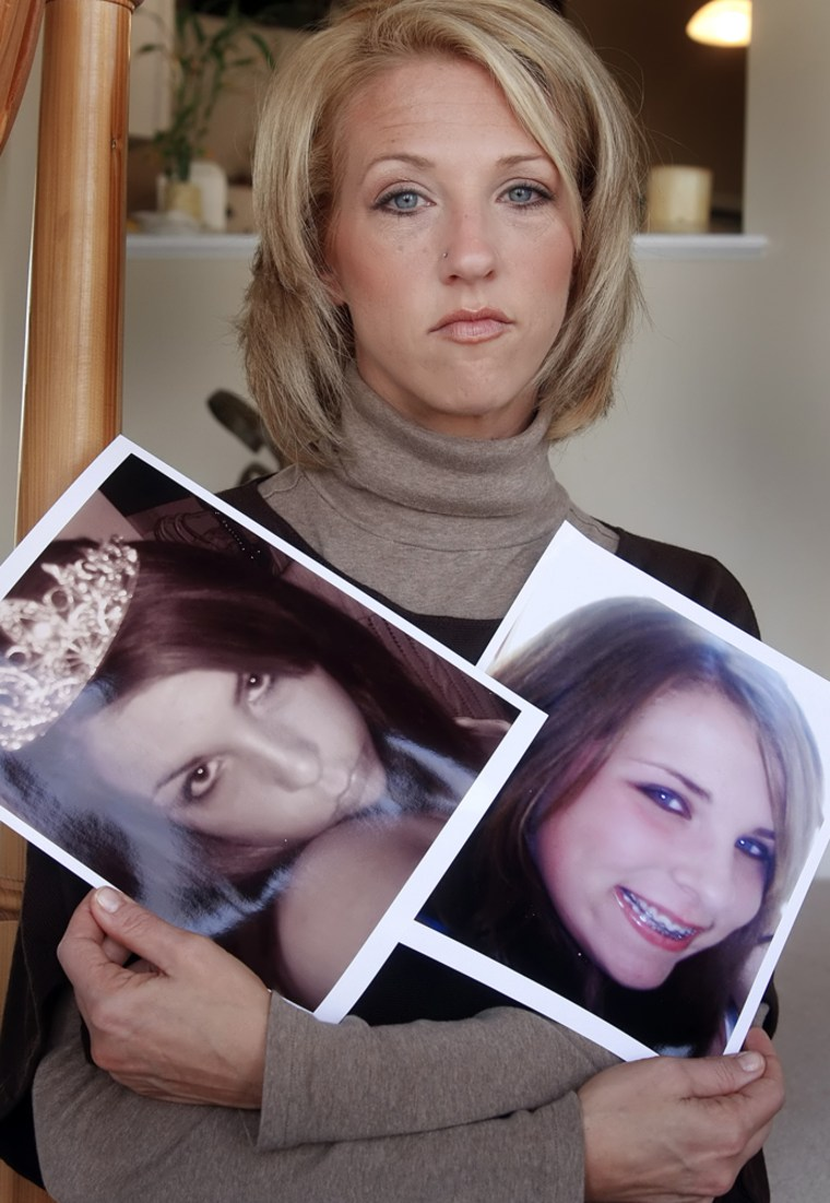 Image:  Tina Meier holds two pictures of her daughter Megan