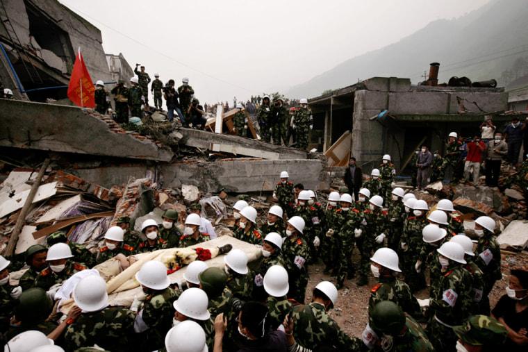Image: Rescuers carry out a survivor