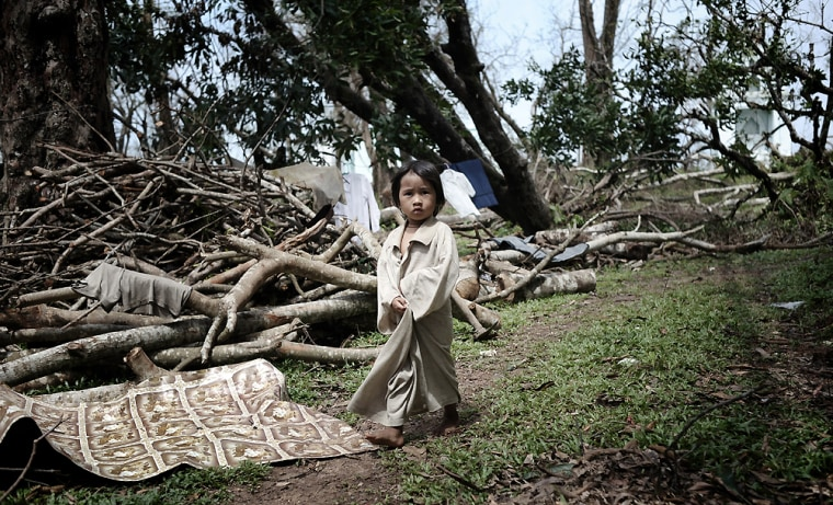 A young girl affected by the cyclone walks near a monastery where she and her family found shelterin the delta region south of Yangon on Friday.