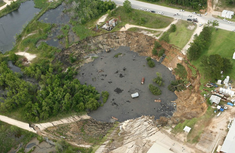 A massive sinkhole near Daisetta, Texas,apparently is now home to an alligator.