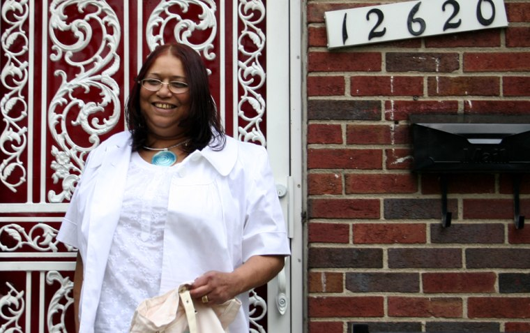 Linda Hutcherson, who is biracial,leaves her home ina nearlyall-black neighborhood in Detroit.