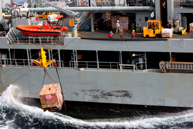 Image: US navy ships awaiting approval to transfer aid supplies to cyclone-struck Myanmar