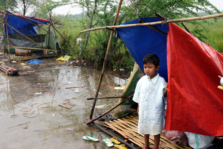 Image: A boy at a makeshift tent in Myanmar