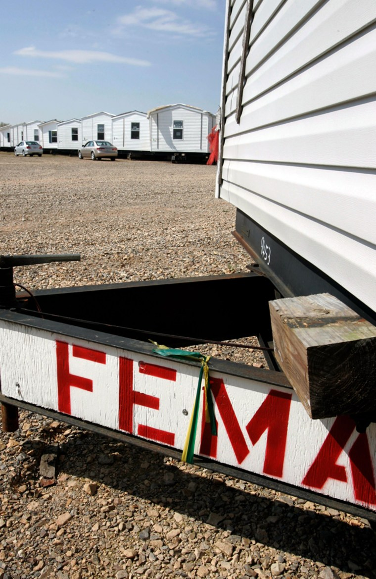 Image: Some of more than 7,500 mobile homes owned by the Federal Emergency Management Agency being stored at the Hope Municipal Airport near Hope, Ark.