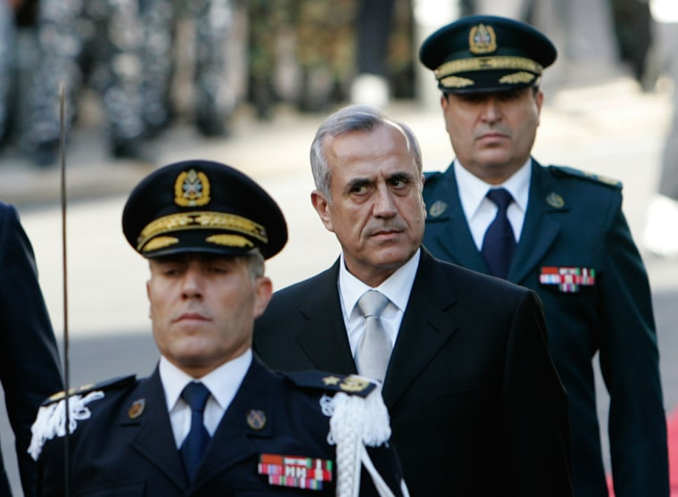 Image: Newly-elected Lebanese President Michel Suleiman, center, reviews the honor guard upon his arrival at the Lebanese Parliament, in Beirut, Lebanon