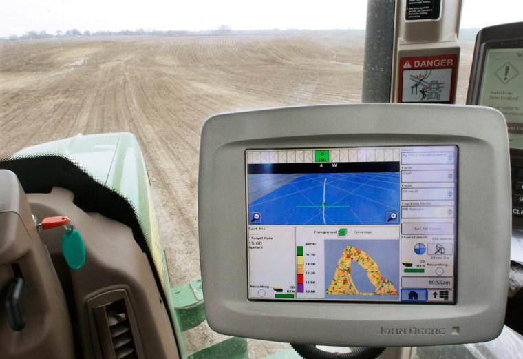 One farmer uses GPS technology in his tractor to reduce the amount of fertilizer and herbicides sprayed.