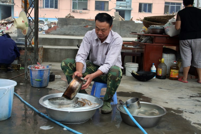 Wang Jinmu, a retired factory worker, came to hard-hit Qingchuan to volunteer for relief efforts and became the de facto chef for the government staff.