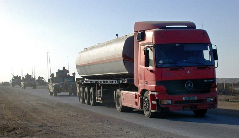 Image: Fuel tankers drive through the western Iraqi desert