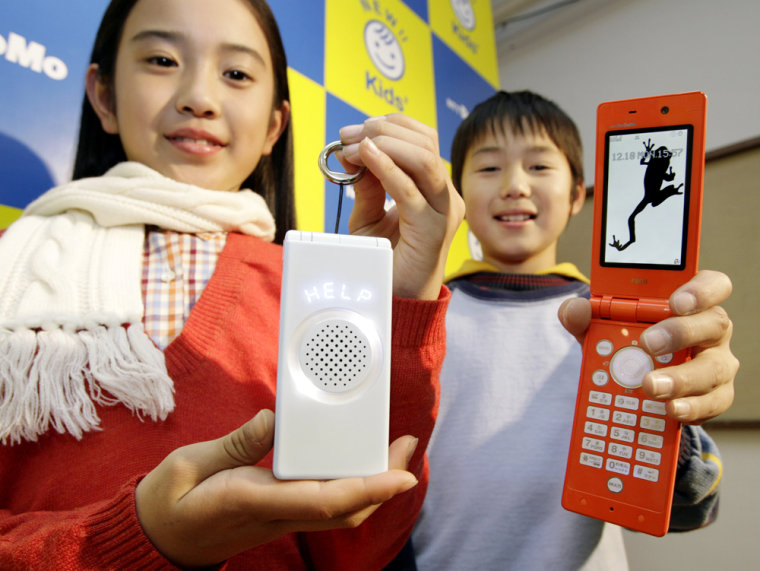 """The Japanese government is asking mobile manufacturers to develop models with only the talking function and navigation. NTT DoCoMo's """"kids' mobile phone,"""" displayed here, comes with GPS."""