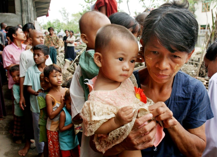 Homeless Burmese receive candy from an overseas donor at a monastery serving as a temporary shelter for cyclone victims on the outskirts of Yangon, Myanmar, earlier this week, one of many shelters reportedly being cleared.