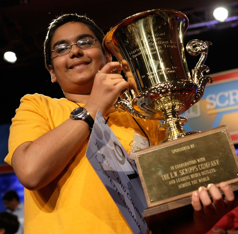 Image: Sameer Mishra of West Lafayette, Indiana, holds up his winning trophy in the 2008 Scripps National Spelling Bee