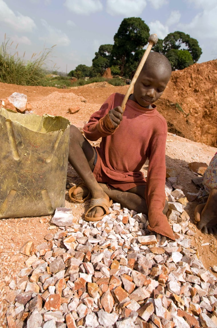 StephenBatte,who lost his mother in the quarry in January when she was buried by a mud slide, breaks rocks in the Acholi Quarters, a slumoutside theUganda capital.
