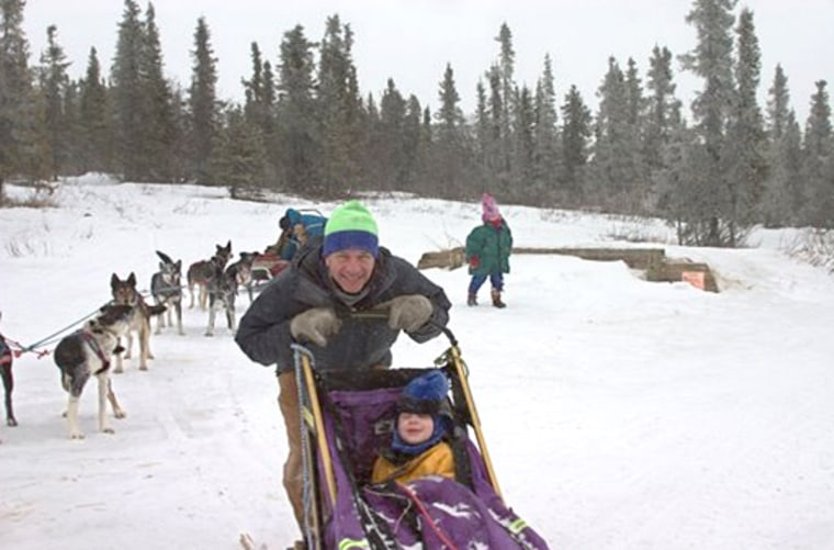 Ethan Berkowitz, a Democratic legislator trying to unseat Alaska's longtime Republican Rep. Don Young in Congress, takes son Noah on a dog sled ride.