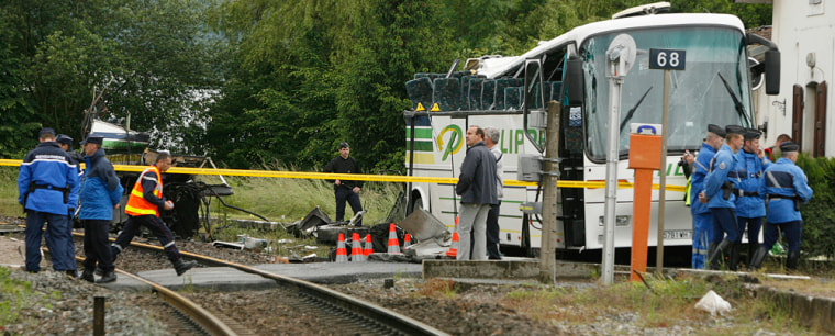 Image: Site of a coach crash at a railway crossing in France