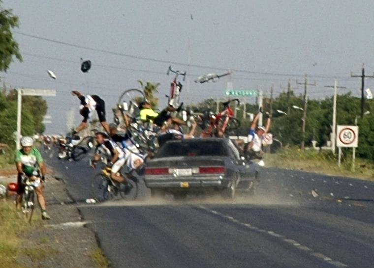 Image: Car crashes into bike race