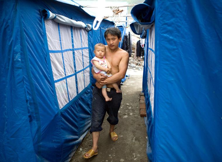 China - Sichuan - Yingxiu - Earthquake - A Man Walks with Baby