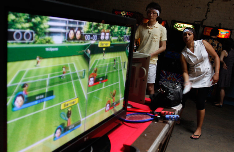 Participants play in the second annualWii Tennis tournament at Barcade inWilliamsburg, Brooklyn.