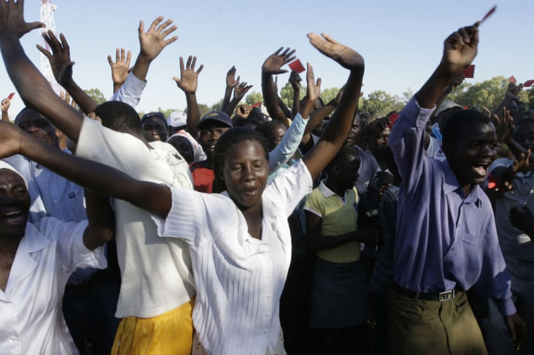 Movement For Democratic Change supporters greet Morgan Tsvangiraion his arrival at his first rally in Kwekwe, Zimbabwe on Sunday.