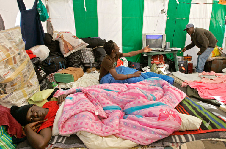 Image: Zimbabwe nationals in a make shift refugee camp near Cape Town