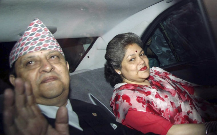 Image: Nepals deposed King Gyanendra, left, and Queen Komal