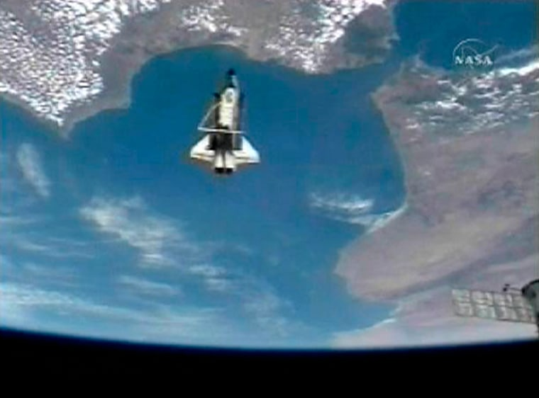 Image: Space Shuttle Discovery and Earth after undocking from ISS