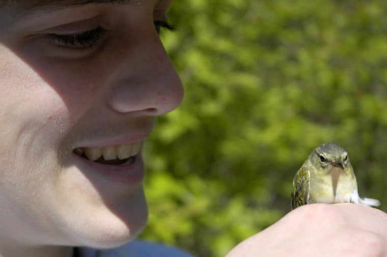 Image: Greg Lawrence holds a bird