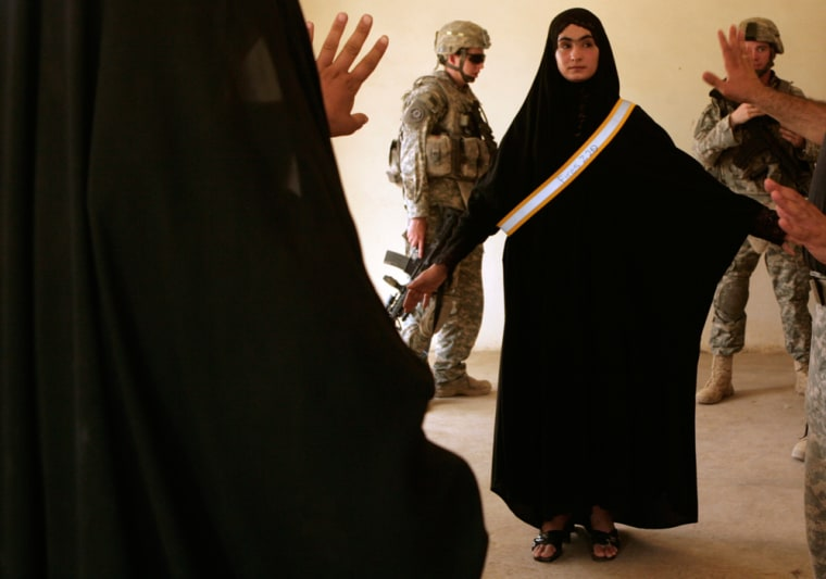 U.S. Army soldiers observe Daughters of Iraq security volunteers practicing their search techniques in Zaganiyah, north of Baghdad in Iraq's volatile Diyala province on Saturday.