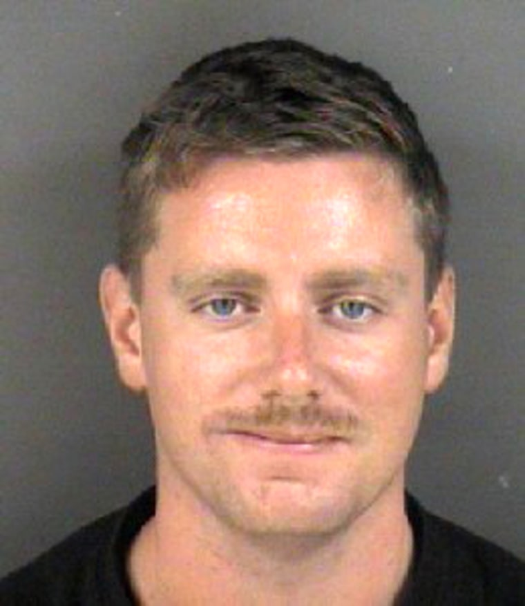 Marine Cpl. John Wimunc is charged with murder and arson in his wife's death.