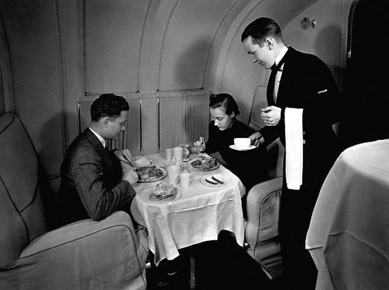 Two passengers dine aboard a Pan American Martin Clipper flying boat. The 1930s transoceanic service offered the height of luxury — but at prices that would equal $10,000 a ticket in today's dollars.