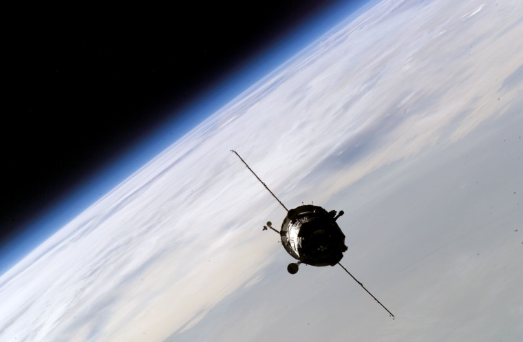 A Russian Soyuz crew capsule approaches the international space station for docking in October 2003. Russia is contractually bound to provide free Soyuz rides to NASA until the end of 2005.