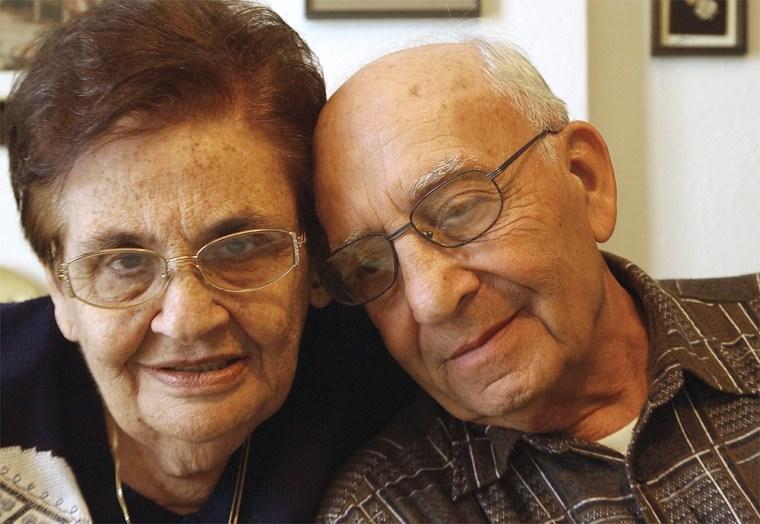 Shoshana November, 73, left, and her brother Binyamin Shilon, 78, right, pose for a photo Monday.