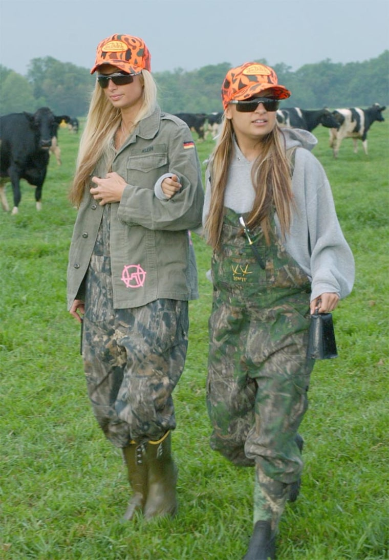 """Paris Hilton (left) and Nicole Richiework on a dairy farm in Fox's """"The Simple Life."""" The success of reality TV shows has promptedthe major networks to stick withsimple program ideas."""