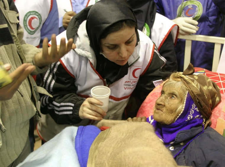 IRANIAN WOMAN RECEIVES TREATMENT AFTER BEING BURIED FOR EIGHT DAYS IN BAM EARTHQUAKE