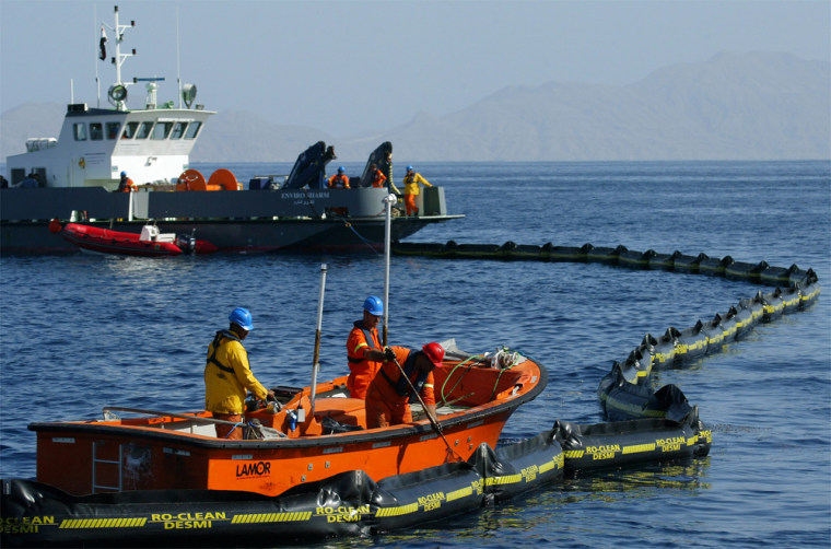 Egyptian environmental workers gatherdebris from the wreckage of an Egyptian charter airplane Monday at the crash scene in the Red Sea off the resort city of Sharm el-Sheik, Egypt.