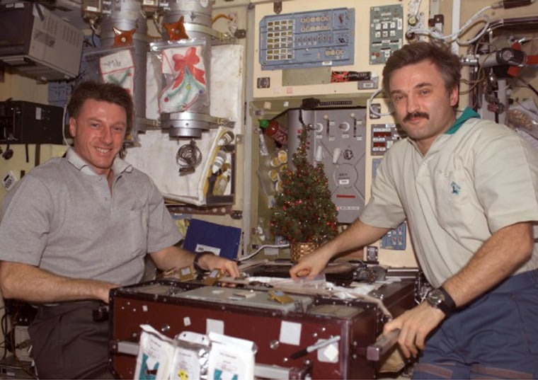 NASA astronaut Michael Foale and Russian cosmonaut Alexander Kaleri celebrated New Year's Day on the space station,then were notified Monday thatthe air pressure was slowly dropping.