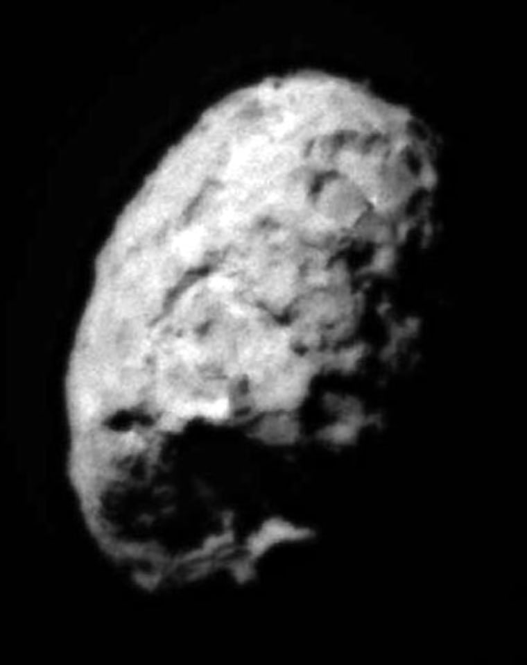 The second image of Comet Wild 2 to be released shows one hemisphere in sunlight and the other in shadow, like a view of the quarter moon. Several large depressed regions can be seen. The comet is about 3.1 miles (5 kilometers) in diameter.