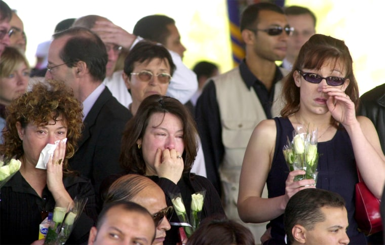 Frenchcitizens attend a memorial service Thursday in the Egyptian Red Sea resort of Sharm el-Sheik.