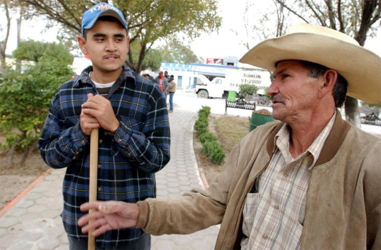 Alejandro Chapa, left, and Ismael Gonzalez Cantu in the town of General Bravo, Mexico, express doubt over Bush's immigration plan.