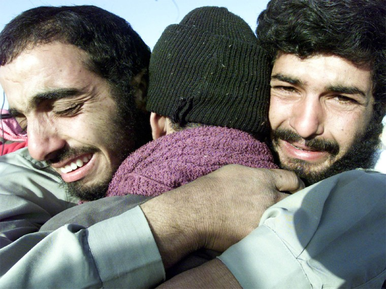 IRAQI PRISONERS EMBRACE ON RELEASE FROM U.S. CUSTODY IN ABU GHRAIB