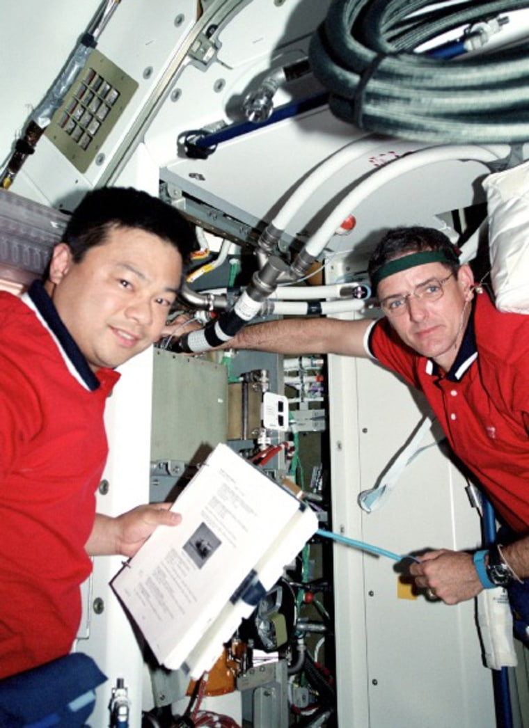 A photo from October 2000 shows Leroy Chiao and Bill McArthur aboard the space station's Russian-built Zarya cargo module during a shuttle mission. Chiao is to replace McArthur as station commander for Expedition 9.